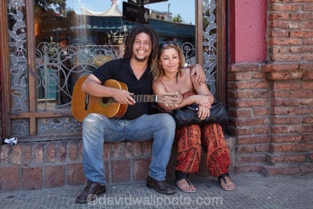 Barrio-Bellavista;Bellavista;Calle-Constitucion;calle-Dardignac;capital-cities;capital-city;Capital-of-Chile;Chile;Constitucion-St;couple;Dardignac-St;footpath;footpaths;guitar;pair;people;person;Santiago;sidewalk;sidewalks;South-America;Sth-America;street;street-scene;street-scenes;streets;young-couple;young-couples