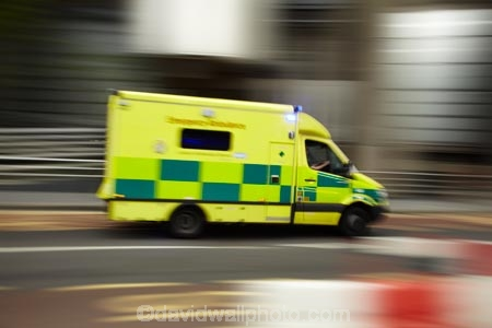 4051;accident;accidents;Ambulance;Ambulances;blur;blurred;blurring;blurry;britain;dayglo;dayglow;emergencies;emergency;emergency-vehicle;emergency-vehicles;england;Europe;fast;fluorescent;fluro;G.B.;GB;great-britain;green;kingdom;london;movement;quick;speed;street-scene;street-scenes;The-City-of-London;U.K.;uk;united;United-Kingdom