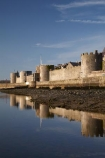 Afon-Seiont;battlement;battlements;Britain;British-Isles;building;buildings;Caernarfon;Caernarfon-Castle;Caernarfon-town-walls;calm;Carnarvon;Carnarvon-Castle;castellated;castellations;castle;castles;crenellation;crenellations;Cymru;fort;fortification;fortress;fortresses;G.B.;GB;Great-Britain;Gwynedd;heritage;historic;historic-building;historic-buildings;historical;historical-building;historical-buildings;history;medieval-castle;medieval-castles;old;placid;quiet;reflection;reflections;River-Seiont;serene;smooth;still;stone-buidling;stone-building;stone-buildings;tradition;traditional;tranquil;U.K.;UK;UN-world-heritage-site;UNESCO-World-Heritage-Site;United-Kingdom;united-nations-world-heritage-site;Wales;water;Welsh-Castle;Welsh-Castles;Welsh-Flag;Welsh-flags;world-heritage;World-Heritage-Park;World-Heritage-site;World-Heritage-Sites
