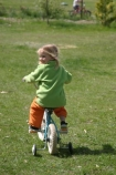 girl;girls;little;child;children;play;playing;playground;play_ground;play-ground;playgrounds;play_grounds;play-grounds;grass;green;grassy;outdoor;outdoors;outside;playtime;fun;moving;movement;childhood;happiness;happy;joy;kid;kids;bike;bikes;cycle;cycles;bicycle;bicycles;two_wheeler;two-wheeler;two_wheelers;two-wheelers;training-wheels;training_wheels;learn;learns;learning;learner;first-ride;ride;rider;riding;riders;training;daughter