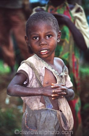 boy;boys;young;rag;rags;poor;poverty;child;children;kid;kids;clasp;clasped;clasped-hands;africa;african;africans;black;ethnic;person;portrait;portraits;tradition;traditional;culture;cultural;tribe;tribal;east-africa;central-africa;democratic-republic-of-congo;congo;zaire;jungle;rainforest;east-africa;central-africa