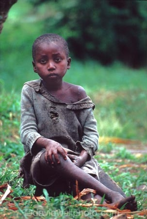girl;girls;young;rag;rags;child;children;kid;kids;rest;resting;relax;relaxing;casual;crossed-legs;legs-crossed;cross;crossover;young;rag;rags;poor;poverty;child;children;kid;kids;africa;african;africans;black;ethnic;person;portrait;portraits;tradition;traditional;culture;cultural;tribe;tribal;east-africa;central-africa;emocratic-republic-of-congo;congo;zaire;jungle;rainforest;east-africa;central-africa
