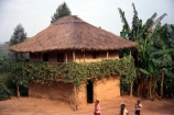 africa;african;africans;hut;huts;home;home;house;housing;dwelling;residence;two-storey;two_storey;two-story;two_story;two-tiered;two_tiered;thatch;thatch-roof;thatched;mud;mud-hut;mud_hut;child;children;entrance;door;balcony;bush;tree;trees;poor;poverty;tradition-;tradtitions;traditional;culture;cultures;cultural;third-world;zaire;congo;democratic-republic-of-congo;banana-palm