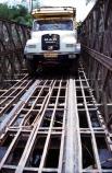 truck;vehicle;travel;travelling;transport;transportation;diesel;diesel-truck;carry;passenger;passengers;track;road;bridge;bridges;crossing;metal;steel;front