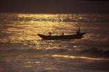 Fisherman;african;fishermen;fishing;silhouette;sunset;sunrise;ocean;sea;atlantic;elmina;ghana;ghanain;west-africa;sahel;light;boat;boats;fishing-boat;fishing-boats;dawn