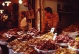 africa;african;africans;north-africa;moroccan;shop;shops;stall;stalls;market;markets;piles;display;displayed;travel;morocco;north-africa;produce;food;basin;basins;dried-fruit;fruit;fruits;nut;nuts;dates;walnuts;banana;vendor;man;seller;shopkeeper