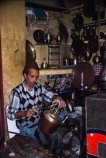 africa;african;africans;ethnic;male;people;person;persons;tradition;traditional;culture;cultural;cultures;north-africa;islam;islamic;muslim;moroccan;shop;shops;stall;stalls;metalwork;metal;silver;brass;copper;bronze;handmade;hand_made;hand-made;plate;plates;craft;craftwork;artisan;handcraft;handcrafts;tradesman;tradesmen;metalworker;metalworkers;metalwork-shop;morocco;fez;fes;african;north-africa;medina;engraving;engraver;engrave