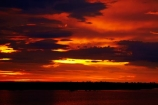 Africa;Botswana;calm;Chobe-River;Chobe-Safari-Lodge;dusk;evening;Kasane;night;night_time;nightfall;orange;placid;quiet;reflected;reflection;reflections;river;rivers;Sedudu-Bar;serene;smooth;Southern-Africa;still;Sunset;Sunset-Bar;sunsets;tranquil;twilight;water