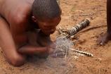 Africa;African;African-people;Bushman;Bushman-Living-Museum;Bushmanland;Bushmen;cultural;cultural-exchange;culture;demonstration;demonstrations;fire;fire-craft;fire-lighting;fire-lighting-with-sticks;Fire-making;fire-starting;fire-starting-with-sticks;fires;forager-society;Grashoek;Grashoek-Living-Museum;Grashoek-village;hunter_gatherer;Hunting-and-gathering;Ju-Hoansi_San-Living-Museum;JuHoansi;JuHoansi_San-men;JuHoansi_San-people;Living-Museum;Living-Museum-of-the-Ju-Hoansi_San;Living-Museum-of-the-JuHoansi_San;Living-Museums;making-fire;making-fires;Namibia;Namibia,-Africa;Otjozondjupa-District;Otjozondjupa-Region;people;person;rubbing-sticks-together;San;San-Living-Museum;San-people;smoke;Southern-Africa;tradition;traditional;Traditional-Bushman-Culture;traditional-clothing;traditional-costume;traditional-dress;traditional-fire-lighting;Traditional-San-Culture;tribe