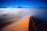 Sossusvlei;Namib_Naukluft-National-Park;national-park;Namibia;Southern-Africa;Africa;African;arid;aridity;barren;barreness;desert;deserts;deserted;empty;wilderness;solitude;sand-dune;dunes;sand_dune;sand_dunes;natural;nature;hot;remote;landscape;landscapes;desolate;desolation;ecosystem;ecosystems;loneliness;orange;red;namib;curve;curves;line;lines;misty;ripple;ripples;sand;sand-dune;sand-dunes;dune;dunes;cloud;mist;fog;low-cloud;slope;slopes;angle;sparse