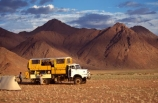 wilderness-camping;Namib-Desert;Namibia;Southern-Africa;Africa;African;plain;plains;landscape;sparse;empty;desert;deserted;africa;african;wilderness;vast;barren;desolate;desolation;dried;dry;land;ground;outdoor;outdoors;outside;surface;surfaces;camp;camping;camper;campers;truck;trucks;tent;tents;4wd;four-wheel-drive;4-x-4;4x4;suv;ruv;mountain;mountains;sand;sandy;adventure;tourism;holiday;holidays;vacation;vacation;safari;safaris
