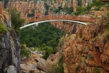Africa;African;bluff;bluffs;Blyde-River;Blyde-River-Canyon-Nature-Reserve;Bourkes-Luck-Potholes;Bourkes-Luck-Potholes;bridge;bridges;canyon;canyons;cliff;cliffs;Eastern-Transvaal;eroded;erosion;foot-bridge;foot-bridges;footbridge;footbridges;Moremela;Motlatse-Canyon-Provincial-Nature-Reserve;Mpumalanga;Mpumalanga-province;pedestrian-bridge;pedestrian-bridges;people;person;ravine;ravines;South-Africa;Southern-Africa;tourist;tourists