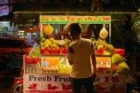 Asia;Cambodia;colorful;colour;colourful;commerce;commercial;dark;dusk;evening;food;food-market;food-markets;food-stall;food-stalls;fruit;fruit-and-vegetables;fruit-market;fruit-markets;fruit-stall;fruit-stalls;Indochina-Peninsula;Kampuchea;Kingdom-of-Cambodia;light;lighting;lights;market;market-place;market_place;marketplace;markets;motocyclist;motorcyclists;night;night-time;night_time;pedestrians;people;person;produce;produce-market;produce-markets;retail;retailer;retailers;shop;shopper;shoppers;shopping;shops;Siem-Reap;Siem-Reap-Province;Southeast-Asia;stall;stalls;steet-scene;street-scenes;twilight