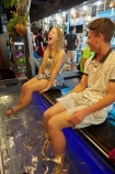 Asia;bare-feet;barefoot;boy;boys;Cambodia;dead-skin;doctor-fish;feet;fish;fish-massage;fish-massages;fish-pedicure;fish-pedicures;fish-tank;fishes;foot;foot-massage;foot-massages;Garra-rufa;girl;girls;Indochina-Peninsula;Kampuchea;kangal-fish;Kingdom-of-Cambodia;laugh;laughing;model-release;model-released;MR;nibble-fish;people;person;Siem-Reap;Siem-Reap-Province;Southeast-Asia;teenager;teenagers;tickle;tickling;tourism;tourist;tourists;young-tourist;young-tourists
