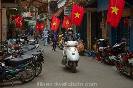 Asia;Asian;bike;bikes;female;flag;flags;Hanoi;Hanoi-Old-Quarter;motorbike;motorbikes;motorcycle;motorcycles;motorscooter;motorscooters;Old-Quarter;people;person;red-flag;red-flags;scooter;scooters;South-East-Asia;Southeast-Asia;step_through;step_throughs;street;street-scene;street-scenes;streets;Vietnam;Vietnam-Flag;Vietnam-Flags;Vietnamese;Vietnamese-Flag;Vietnamese-Flags;woman;women