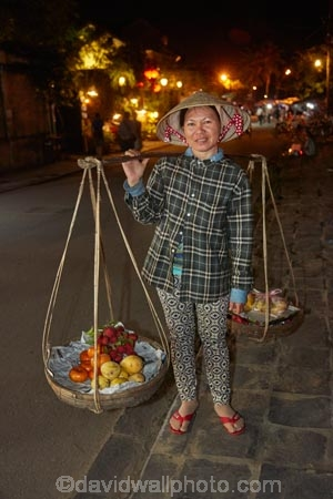 Asia;Asian;bamboo-yoke;bamboo-yokes;carrying-pole;carrying-stick;Central-Sea-region;dark;dusk;evening;female;females;fruit;Hi-An;hanging-basket;hanging-baskets;Hoi-An;Hoi-An-Old-Town;Hoian;Indochina;ladies;lady;milkmaids-yoke;night;night-time;night_time;old-town;people;person;produce;shoulder-pole;South-East-Asia;Southeast-Asia;twilight;UN-world-heritage-area;UN-world-heritage-site;UNESCO-World-Heritage-area;UNESCO-World-Heritage-Site;united-nations-world-heritage-area;united-nations-world-heritage-site;Vietnam;Vietnamese;woman;women;world-heritage;world-heritage-area;world-heritage-areas;World-Heritage-Park;World-Heritage-site;World-Heritage-Sites;yoke;yokes