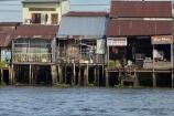 Asia;Asian;boat-market;Cn-Tho;Cai-Rang;Cai-Rang-floating-market;calm;Can-Tho;Can-Tho-City;Can-Tho-River;corrugated-iron;corrugated-steel;Cái-Rang;Cái-Rang-Floating-Market;floating-market;floating-markets;market;markets;Mekong-Delta;Mekong-Delta-Region;Mekong-River;shanties;shanty;South-East-Asia;Southeast-Asia;stilt;stilt-house;stilt-houses;stilts;Vietnam;Vietnamese;water-market