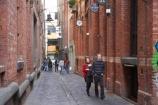 alley;alleys;alleyway;alleyways;Australia;back-street;back-streets;cobblestone;cobblestoned;cobblestones;Historic;lane;lanes;Marks-Warehouses-1887;Melbourne;Niagara-Lane;pedestrian;people;person;street-scene;street-scenes;VIC;Victoria