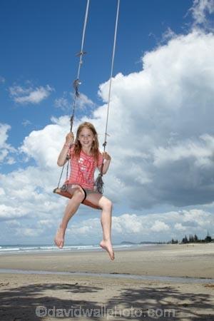 10-year-old;10-years-old;9-year-old;9-years-old;beach;beaches;child;children;coast;coastal;Coromandel;Coromandel-Peninsula;fun;girl;girls;happy;joy;kid;kids;kiwi-icon;kiwi-icons;kiwiana;little-girl;little-girls;N.I.;N.Z.;New-Zealand;NI;nine-year-old;nine-years-old;North-Is;North-Is.;North-Island;NZ;outdoor;outside;people;person;play;playing;Pohutukawa-Tree;Pohutukawa-Trees;rope-swing;rope-swings;shore;summer;swing;swinging;swings;ten-year-old;ten-years-old;Waihi-Beach;Waikato;young-girl;young-girls