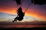 10-year-old;10-years-old;9-year-old;9-years-old;child;children;coast;coastal;Coromandel;Coromandel-Peninsula;dusk;evening;Firth-of-Thames;fun;girl;girls;happy;joy;kid;kids;kiwi-icon;kiwi-icons;kiwiana;little-girl;little-girls;N.I.;N.Z.;New-Zealand;NI;nightfall;nine-year-old;nine-years-old;North-Is;North-Is.;North-Island;NZ;orange;outdoor;outside;people;person;play;playing;Pohutukawa-Tree;Pohutukawa-Trees;rope-swing;rope-swings;shore;silhouette;silhouettes;sky;summer;sunset;sunsets;swing;swinging;swings;Tararu;ten-year-old;ten-years-old;Thames;Thames-Coast;twilight;Waikato;young-girl;young-girls