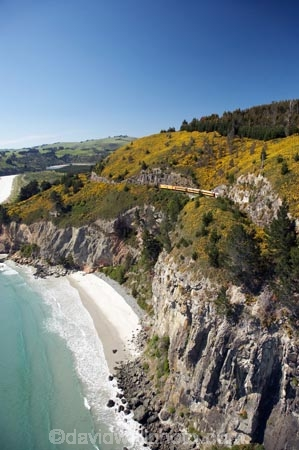 aerial;aerial-photo;aerial-photograph;aerial-photographs;aerial-photography;aerial-photos;aerial-view;aerial-views;aerials;beach;beaches;bluff;bluffs;carriage;carriages;cliff;cliffs;coast;coastal;coastline;coastlines;coasts;containers;Doctors-Point;Doctors-Point;Dunedin;gorse;N.Z.;New-Zealand;NZ;ocean;oceans;Otago;Pacific-Ocean;passenger-train;passenger-trains;rail;railroad;railroads;rails;railway;railways;S.I.;sand;sandy;sea;seas;Seasider-Train;shore;shoreline;shorelines;shores;SI;sightseeing-train;South-Is.;South-Island;steep;The-Seasider-Train;tourism;track;tracks;train;trains;transport;transportation;travel;Waitati;water