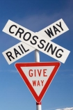 cross;crosses;give-way-sign;level-crossing;level-crossings;Middlemarch;N.Z.;New-Zealand;NZ;Otago;rail;rail-crossing;rail-crossings;railroad;railroads;railway;railway-crossing;railway-crossings;railways;S.I.;SI;sign;signage;signs;South-Is.;South-Island;Strath-Taieri;Sutton;tracks;train;trains;transport;transportation;twilight;warning;warning-sign;warning-signs;x