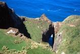 cliff;cliffs;dunedin;tunnel-;bluff;bluffs;precipice;person;;high;sea;ocean;pacific;coastline;coast;rock;otago-peninsula;aerial;aerials;cave;caves;arch;arches;hole;view-point