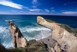 cliff;cliffs;dunedin;tunnel-beach;bluff;bluffs;precipice;person;;high;sea-ocean;pacific;coastline;coast;rock;beaches;wave;waves