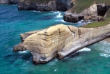 aerial;aerials;cliff;cliffs;dunedin;tunnel-beach;bluff;bluffs;precipice;person;;high;sea-ocean;pacific;coastline;coast;rock