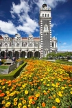 1906;architecture;building;buildings;city-gardens;clock;clock-tower;clock-towers;color;colorful;colors;colour;colourful;colours;council-gardens;Dunedin;Dunedin-Railway-Station;Flemish-Renaissance-style;floral;flower;flower-bed;flower-beds;flower-garden;flower-gardens;flowers;garden;gardens;George-A-Troup;Gingerbread-George;heritage;Historic;historic-building;historic-buildings;historical;historical-building;historical-buildings;history;New-Zealand;old;Otago;rail-station;rail-stations;railway;railway-station;railway-stations;railways;South-Island;tradition;traditional;train-station;train-stations;yellow
