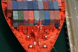 ship;container;containers;orange;red;row;rows;stack;stacks;stacked;stacking;rope;ropes;dock;docked;docking