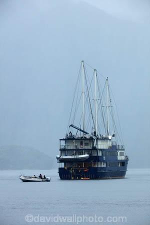 bad-weather;black-cloud;black-clouds;boat;boats;cloud;clouds;cloudy;cruise;cruise-boat;cruise-boats;cruises;dark-cloud;dark-clouds;Doubtful-Sound;fiord;Fiordland;Fiordland-N.P.;Fiordland-National-Park;Fiordland-Navigator;Fiordland-NP;fiords;fjord;fjords;gray;gray-cloud;gray-clouds;grey;grey-cloud;grey-clouds;IRB;N.Z.;national-park;national-parks;New-Zealand;NZ;Patea;pleasure-boat;pleasure-boats;rain;rain-cloud;rain-clouds;raining;rains;rainy;Real-Journeys;RHIB;RIB;rigid-inflatable-boat;S.I.;SI;South-IS;South-Island;Southland;Sth-Is;Te-Waipounamu;Te-Waipounamu-World-Heritage-Site;tour-boat;tour-boats;tourism;tourist-boat;tourist-boats;UN-world-heritage-area;UN-world-heritage-site;UNESCO-World-Heritage-area;UNESCO-World-Heritage-Site;united-nations-world-heritage-area;united-nations-world-heritage-site;weather;world-heritage;world-heritage-area;world-heritage-areas;World-Heritage-Park;World-Heritage-site;World-Heritage-Sites