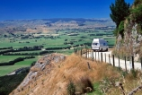 camper-van;campervans;countryside;farm;farms;fence;fences;gravel;motor-home;motor-homes;motorhome;motorhomes;road;roads;touring;tourism;tourist;tourists;travel;vans;view