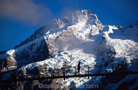 ice;snow;silhouette;silhouettes;bridges;swing-bridge;wire-bridge;wilderness;mountain;mountains;peak;glacier;glaciers;southern-alps;main-divide;walk;walks;walker;walkers;walking;tramp;tramps;tramper;trampers;tramping;adventure;person;people;hike;hikers;hiker;hiking;hooker;river;footbridge;footbridges;mt-sefton;mt-cook;aoraki;mat-cook-national-park;national-park;national-parks;single;adventurous;adventurer;adventurers