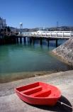 cement;color;colour;concrete;dingys;dock;docked;harbor;harbour;orange;ramp;red;rowboat;water