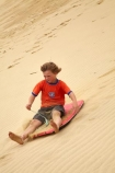 action;adrenaline;adventure;adventure-tourism;boogie-boarding;boy;boys;child;children;dune;dune-board;dune-boarding;dune-surfing;dunes;excite;excitement;exciting;Far-North;fast;fun;kid;kids;little-boy;little-boys;N.I.;N.Z.;New-Zealand;NI;North-Is;North-Is.;North-Island;Northland;NZ;people;person;sand;sand-boarding;sand-dune;sand-dunes;sand-hill;sand-hills;sand-surfing;sand_dune;sand_dunes;sand_hill;sand_hills;sandboarding;sanddune;sanddunes;sandhill;sandhills;sandsurfing;sandy;scary;speed;Te-Paki-Creek;Te-Paki-Dunes;Te-Paki-Recreational-Reserve;Te-Paki-Reserve;Te-Paki-Sand-Dunes;Te-Paki-Sand-Hills;Te-Paki-Stream;tourism;tourist;tourists