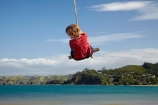 8-year-old;8-years-old;9-year-old;9-years-old;boy;boys;child;children;coast;coastal;coastline;coastlines;coasts;eight-years-old;eigth-year-old;foreshore;fun;happy;joy;kid;kids;kiwi-icon;kiwi-icons;kiwiana;little-boy;little-boys;N.I.;N.Z.;New-Zealand;NI;nine-year-old;nine-years-old;North-Is;North-Is.;North-Island;Northland;NZ;Oakura;Oakura-Bay;outdoor;outside;people;person;play;playing;rope-swing;rope-swings;shore;shoreline;shorelines;shores;sky;summer;summertime;swing;swinging;swings;tidal;tide;water;Whangaruru-Bay;young-boy;young-boys