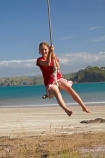 10-year-old;10-years-old;9-year-old;9-years-old;Auckland-Region;beach;beaches;child;children;coast;coastal;coastline;coastlines;coasts;foreshore;fun;girl;girls;happy;joy;kid;kids;kiwi-icon;kiwi-icons;kiwiana;little-girl;little-girls;N.I.;N.Z.;New-Zealand;NI;nine-year-old;nine-years-old;North-Is;North-Is.;North-Island;Northland;NZ;Oakura;Oakura-Bay;ocean;oceans;outdoor;outside;people;person;play;playing;rope-swing;rope-swings;sand;sandy;sea;seas;shore;shoreline;shorelines;shores;sky;summer;summertime;swing;swinging;swings;ten-year-old;ten-years-old;water;Whangaruru-Bay;young-girl;young-girls