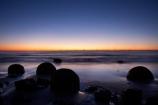 beach;beaches;boulder;break-of-day;calm;coast;coastal;coastline;coastlines;coasts;concretion;dawn;dawning;daybreak;first-light;formation;geological;geology;marble;marbles;Moeraki;Moeraki-Boulder;Moeraki-Boulders;morning;N.Z.;New-Zealand;North-Otago;NZ;ocean;Otago;placid;quiet;reflection;reflections;rock;rocks;round;S.I.;sand;sea;sedementary;serene;shore;shoreline;shorelines;shores;SI;smooth;South-Island;sphere;still;sunrise;sunrises;sunup;tranquil;twilight;Waikati-District;Waitaki-District;water