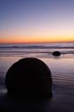 beach;beaches;boulder;break-of-day;coast;coastal;coastline;coastlines;coasts;concretion;dawn;dawning;daybreak;first-light;formation;geological;geology;marble;marbles;Moeraki;Moeraki-Boulder;Moeraki-Boulders;morning;N.Z.;New-Zealand;North-Otago;NZ;ocean;Otago;rock;rocks;round;S.I.;sand;sea;sedementary;shore;shoreline;shorelines;shores;SI;South-Island;sphere;sunrise;sunrises;sunup;twilight;Waikati-District;Waitaki-District