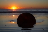 beach;beaches;boulder;break-of-day;calm;coast;coastal;coastline;coastlines;coasts;concretion;dawn;dawning;daybreak;first-light;formation;geological;geology;marble;marbles;Moeraki;Moeraki-Boulder;Moeraki-Boulders;morning;N.Z.;New-Zealand;North-Otago;NZ;ocean;orange;Otago;placid;quiet;reflection;reflections;rock;rocks;round;S.I.;sand;sea;sedementary;serene;shore;shoreline;shorelines;shores;SI;smooth;South-Island;sphere;still;sunrise;sunrises;sunup;tranquil;twilight;Waikati-District;Waitaki-District;water