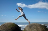 action;beach;beaches;boulder;child;children;coast;coastal;coastline;coastlines;coasts;concretion;foreshore;formation;geological;geology;girl;girls;horizon;jump;jumping;kid;kids;leap;leaping;leaps;little-girl;little-girls;marble;marbles;Moeraki;Moeraki-Boulder;Moeraki-Boulders;N.Z.;New-Zealand;North-Otago;NZ;ocean;Otago;rock;rocks;round;S.I.;sand;sea;sedimentary;shore;shoreline;shorelines;shores;SI;sky;South-Is;South-Is.;South-Island;sphere;unusual-geologocal-feature;unusual-geologocal-features;unusual-natural-feature;unusual-natural-features;unusual-rock;unusual-rocks;Waikati-District;Waitaki-District;Waitaki-Region;water;young-girl;young-girls