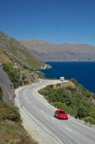 automobile;automobiles;bend;bends;car;cars;centre-line;centre-lines;centre_line;centre_lines;centreline;centrelines;corner;corners;Devilsl-Staircase-Road;Devils-Staircase;driving;highway;highways;lake;Lake-Wakatipu;lakes;N.Z.;New-Zealand;NZ;open-road;open-roads;Otago;Queenstown;red-car;red-cars;road;road-trip;roads;S.I.;SI;South-Island;tranportation;transport;transportation;travel;traveling;travelling;trip;trips;vehicle;vehicles