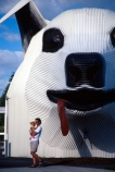 mother-and-child;mother;mothering;baby;carrying;carry;corrugated-iron;corrugated-iron-art;art;sculpture;dog_shape;information-centre;information;centre;tourism;attraction