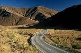 mountain;mountains;range;ranges;road;roads;highway;highways;curve;curves;corner;corners;bend;bends;s;hill;hills;tussock;tussocks