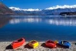 kayak;kayaks;red-kayak;red-kayaks;yellow-kayak;yellow-kayaks;blue-kayak;blue-kayaks;red;yellow;blue;lake;lake-wanaka;still;calm;mountain;mountains;snow-cap;snow-caps;snow-capped;sand;shore;beach;holiday;boat;vacation;relax;relaxing;reflection;reflecting