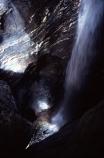 rock;rocks;rocky;climber;climbers;water;rushing-water;canyon;deep;stream;flow;flowing;helmet;helmets;safety-gear;safety-equipment;wet;descent;descend;challenge;falls;falling;bottom;pool