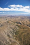 aerial;aerial-photo;aerial-photography;aerial-photos;aerials;agricultural;agriculture;barren;contours;country;countryside;dry;erroded;farm;farming;farmland;farms;High-Country;highland;highlands;Highway-8;hills;hilly;Lindis-Pass;N.Z.;New-Zealand;NZ;Otago;road;rough;rugged;rural;South-Island;State-Highway-8;topography;wild;wilderness
