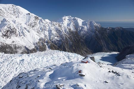 above;aerial;aerial-photo;aerial-photograph;aerial-photographs;aerial-photography;aerial-photos;aerial-view;aerial-views;aerials;Almer-Hut;alp;alpine;alps;back-country-hut;backcountry;backcountry-hut;backcountry-huts;climbers-hut;climbers-huts;cold;danger;DOC-hut;DOC-huts;Franz-Josef-Glacier;glacial;glacier;glaciers;high-altitude;high-country-hut;highcountry;highcountry-hut;highcountry-huts;hikers-hut;hikers-huts;huits;Huntington-Ridge;hut;ice;icy;main-divide;mount;mountain;mountain-hut;mountain-huts;mountaineers-hut;mountaineers-huts;mountainous;mountains;mountainside;mt;mt.;N.Z.;New-Zealand;NZ;outdoors;range;ranges;S.I.;SI;snow;snowy;South-Is.;South-Island;South-West-New-Zealand-World-Heritage-Area;southern-alps;Te-Poutini-National-Park;Te-Wahipounamu;trampers-hut;trampers-huts;West-Coast;Westland;westland-national-park;White;winter;World-Heritage-Area