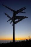 Buller-District;Buller-Region;Cape-Foulwind;Cape-Foulwind-Walkway;direction-sign;direction-signs;distance-sign;distance-signs;dusk;evening;N.Z.;New-Zealand;nightfall;NZ;orange;place-sign;place-signs;S.I.;SI;sign;signs;sky;South-Is;South-Island;sunset;sunsets;twilight;West-Coast;Westland
